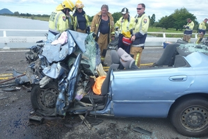 A baby died and three people were injured when this car crashed into a truck. Photo / TrustPower TECT Rescue Helicopter