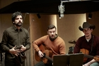 Justin Timberlake (centre) with co-stars Oscar Isaac Adam Driver in a recording studio scene from Inside Llewyn Davis.