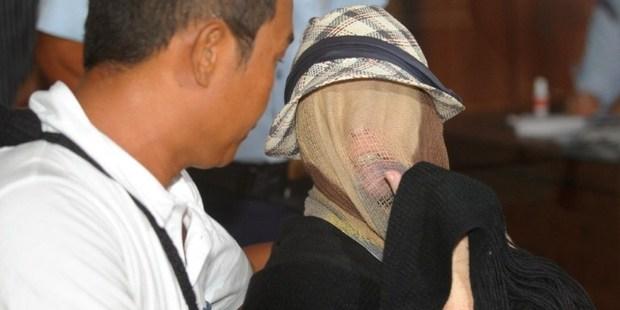 Schapelle Corby's face was covered as she sat at a correction bureau in Denpasar. Photo / AFP