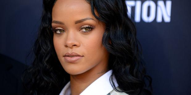 Rihanna says she narrowly avoided bankruptcy in 2009. Photo/AP