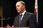 Prime Minister John Key says there are New Zealanders fighting in anti-government forces in Syria while others have been blocked from going there by having their passports cancelled under national security provisions.