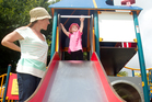 Hamilton mother Dulcie Hooper  and 21-month-old daughter Jasmine check  out one of the metal slides at Hamilton Lake. Photo / Christine Cornege