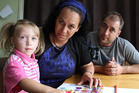 Zita Cameron, her husband Anthony Cameron and their daughter Alexia Cameron, 3.