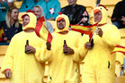 Three chickens braving the rain on day one of 5th round of the HSBC Sevens World Series. Photo / Mark Mitchell