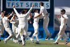The Black Caps celebrate their win against India during the fourth day of the first Test. Photo / Brett Phibbs