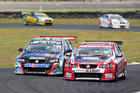 Bad luck robs Evans' chance of beating Murphy in V8s Simon Evans (left car) and Greg Murphy battle it out at Manfeild and (below) celebrate their success. Pictures / Andrew Bright/www.championshipdigital.com
