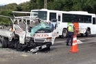 The driver of the truck that collided with a school bus this morning has been taken to Tauranga Hospital.