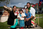 Fitalika (L) and Sione Leha'uli with their children at the opening of the Matanikolo Housing Project in Mangere. Photo / Sarah Ivey