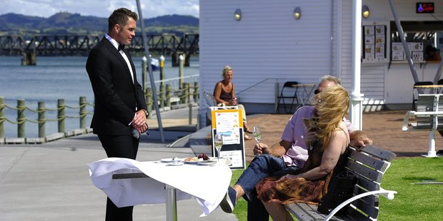 Councillor Matt Cowley treated Tauriko couple Warren and Joelene Young to a surprise Valentine's Day meal on the waterfront. Photo / George Novak