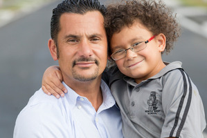 Banapa Avatea with his five-year-old son Jordan. Photo / Greg Bowker