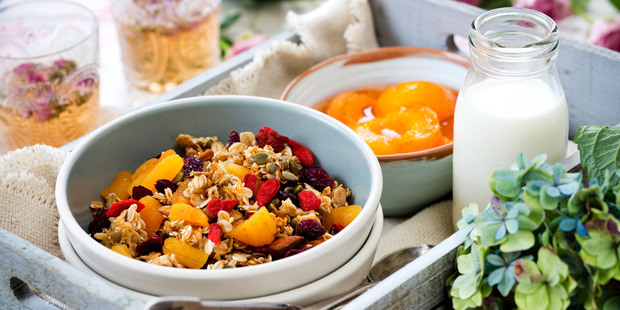 Home-made muesli with poached apricots. Photo / Babiche Martens.
