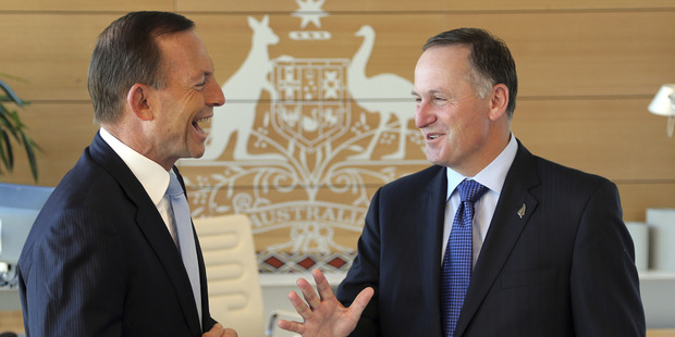 New Zealand Prime Minister John Key, right, is greeted by Australia's Prime Minister Tony Abbott. Photo / Getty Images
