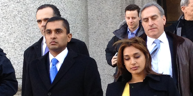 Former SAC Capital Advisors fund manager Mathew Martoma, centre, leaves court with his wife Rosemary Martoma and lawyers. Photo / AP