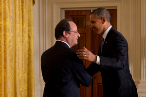 French President Francois Hollande shakes hands with President Barack Obama after their joint news conference. Photo / AP