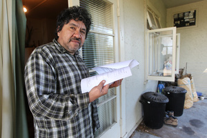 Thomas Martin of Hastings holding papers charging him with not filling out the 2013 census. Photo / Duncan Brown