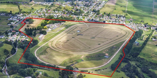 The 36.8ha Paeroa racecourse site and its 1120sq m grandstand.