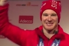 Switzerland's Dario Cologna celebrates winning the cross country skiing men's 15km classic, his second gold of the Sochi Olympics.