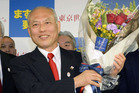 Yoichi Masuzoe celebrates his election victory at his election office in Tokyo. Photo / AP