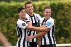 LOVING IT: Jamie Mason (left), celebrating a goal with Aaaron Jones and Harley Rodeka, is enjoying the HB United culture.