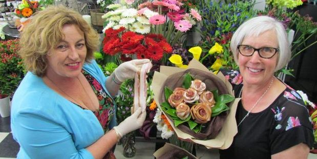 Streaky bacon from Waitaki Bacon and Ham's Sue Morton (left) is made into bouquets and single roses by florist Jonell, Johnson of Jonell's Florists in Oamaru. Photo / David Bruce
