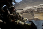 US Air Force pararescuemen fly over a village in Afghanistan. Photo / AP