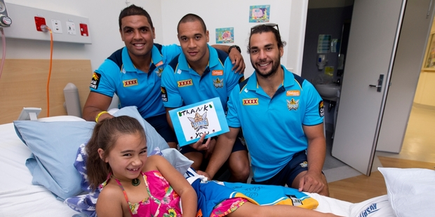 Mark Ioane, Siuatonga Likiliki and Ryan James drop in on Tatyana-Rose Rasmusen. Photo / Dean Purcell