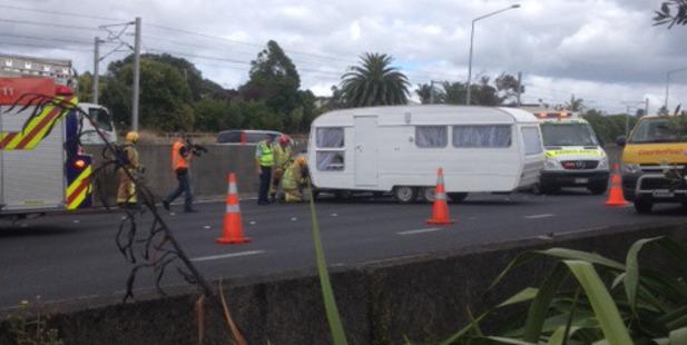 The caravan overturned on the southern motorway. Photo / Karl Quinn