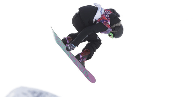 New Zealand's Stefi Luxton takes a jump during the women's snowboard slopestyle semifinal. Photo / AP