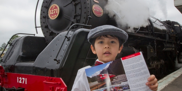 BLAST FROM PAST: Mac Fan-Robertson, 4, from Bay View, was one of many admirers of the Art Deco steam train as it stopped in Hastings for more passengers yesterday. PHOTO/ GLENN TAYLOR HBT140716-03