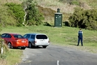 Police stand guard at the entrance to Pukehina Beach where a woman drowned on Saturday. Photo/Andrew Warner