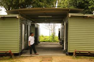An asylum seeker arriving on Manus Island. Photo / AAP
