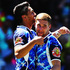 Shaun Johnson of the Warriors celebrates with Sam Tomkins after scoring a try during the match between the New Zealand Warriors and the North Queensland Cowboys. Photo / Getty Images