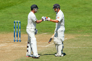 BJ Watling celebrates his century with teammate Brendon McCullum during day four of the second Test match between New Zealand and India. Photo / Getty Images