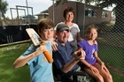 Fraser McRobie with wife Deidre and twins Douglas and Annabelle, 9, at Hillcrest Normal School. Photo / Stephen Barker