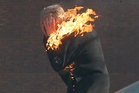 A protester is engulfed by flames during clashes with riot police in the capital Kiev.