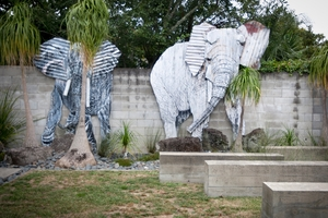 Two large Jeff Thomson corrugated elephants adorn the yard of the Herne Bay home which is for sale. Photo / NZ Herald