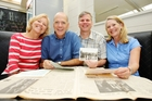 Becky and Jim Brown with Dave and Janice Hansen with Bay of Plenty Times newspaper clippings and other memorabilia from their tour in 1971. Photo/Ruth Keber