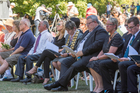 Official guests follow the reading of victims names at the Commemorative Service. Photo / SNPA