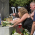 Family members lay flowers at the memorial for victims of the earthquake, Christchurch. Photo / SNPA / David Alexander