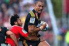 Robbie Fruean of the Chiefs is tackled by Nafi Tuitavake of the Crusaders during the round two Super Rugby match between the Crusaders and the Chiefs. Photo / Getty Images.
