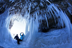 People take pictures of each other in a cave at Apostle Islands National Lakeshore in northern Wisconsin, which has been transformed into a dazzling display of ice sculptures. Photo / AP