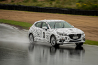 Suitably camouflaged the Mazda3 is put through its paces at Hampton Downs. Picture / Ted Baghurst