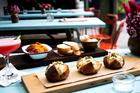From the menu: Moroccan chickpeas, burrata, sloppy mushroom joe, prawn buns, lentil balls, prune and brandy truffles. Photo / Babiche Martens.