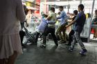 Young men scuffle outside McDonalds, Britomart. Photo / Michael Craig