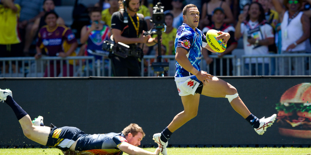 Warriors David Fusitua? scores their first try against the Cowboys in the NRL Auckland Nines at Eden Park, Auckland.16 February 2014 New Zealand Herald Photograph by Richard Robinson.