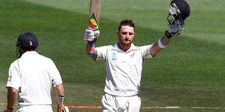 New Zealand captain Brendon McCullum raises his bat aloft after scoring his double-century on day four of the second test against India at the Basin Reserve. Photo / Mark Mitchell