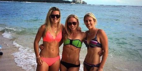 Gemma Flynn, Anita Punt and Emily Naylor flaunt their abs in Hawaii.