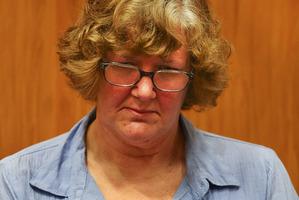 Helen Milner sits in court in Christchurch, New Zealand. Photo / Martin Hunter