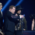 Host James Corden, centre, takes a selfie onstage with US recording artist Prince during at the BRIT Awards 2014. Photo / AP