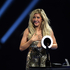 Ellie Goulding reacts on stage upon receiving the award for British Female Solo Artist of the Year at the BRIT Awards 2014. Photo / AP